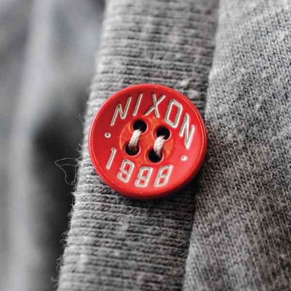 Nixon Red Plastic Button